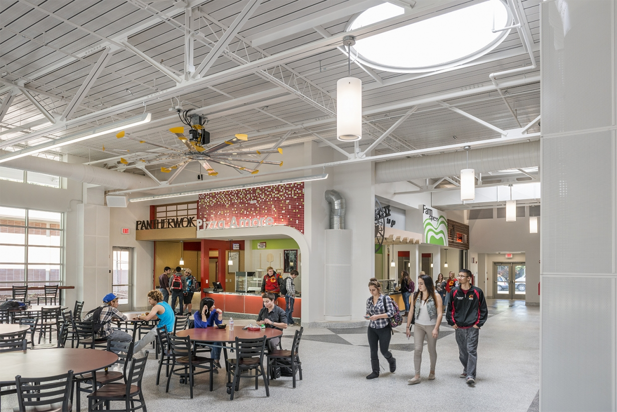 Cylinder pendants accent commercial lighting applications, seen here above a clean food court