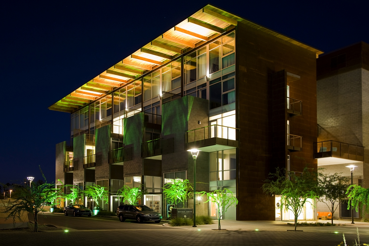 Cypress outdoor light fixtures provide soft uplight for the upper floor of a multifamily building