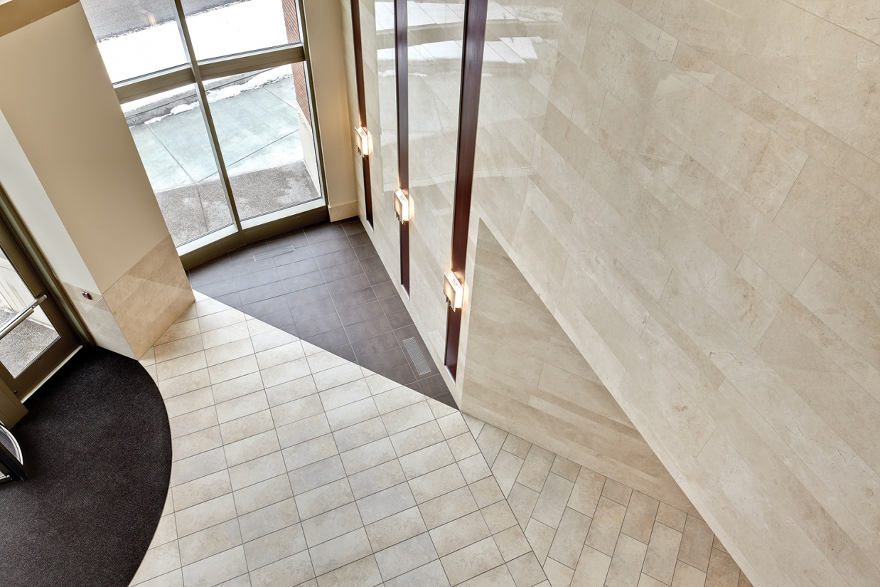 Easel wall sconces in the sleek entryway of a modern healthcare design application