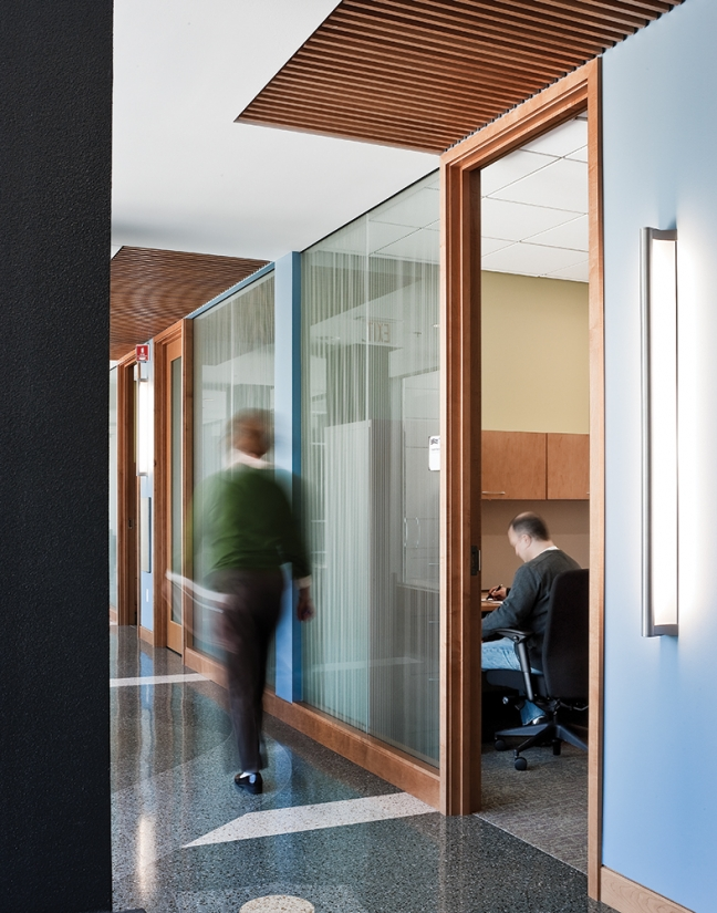 Ether in an education lighting design application, mounted vertically along a campus hallway