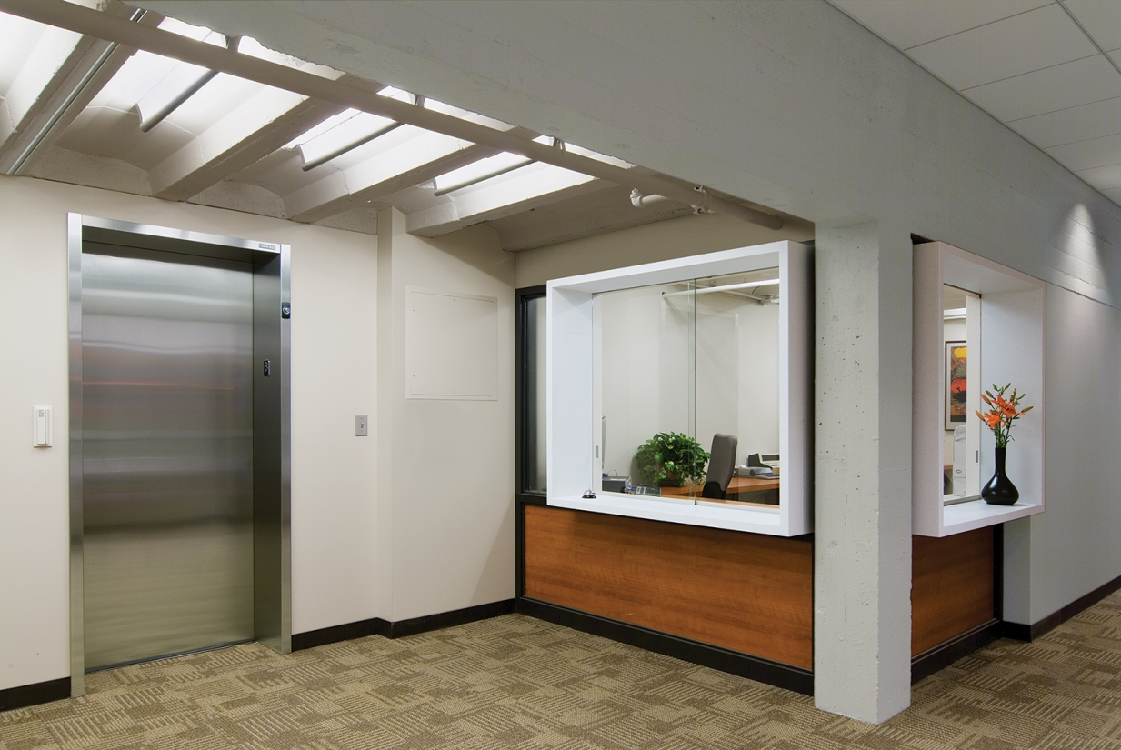 Ether ceiling-mounted luminaires in a medical lighting application above a clinic elevator