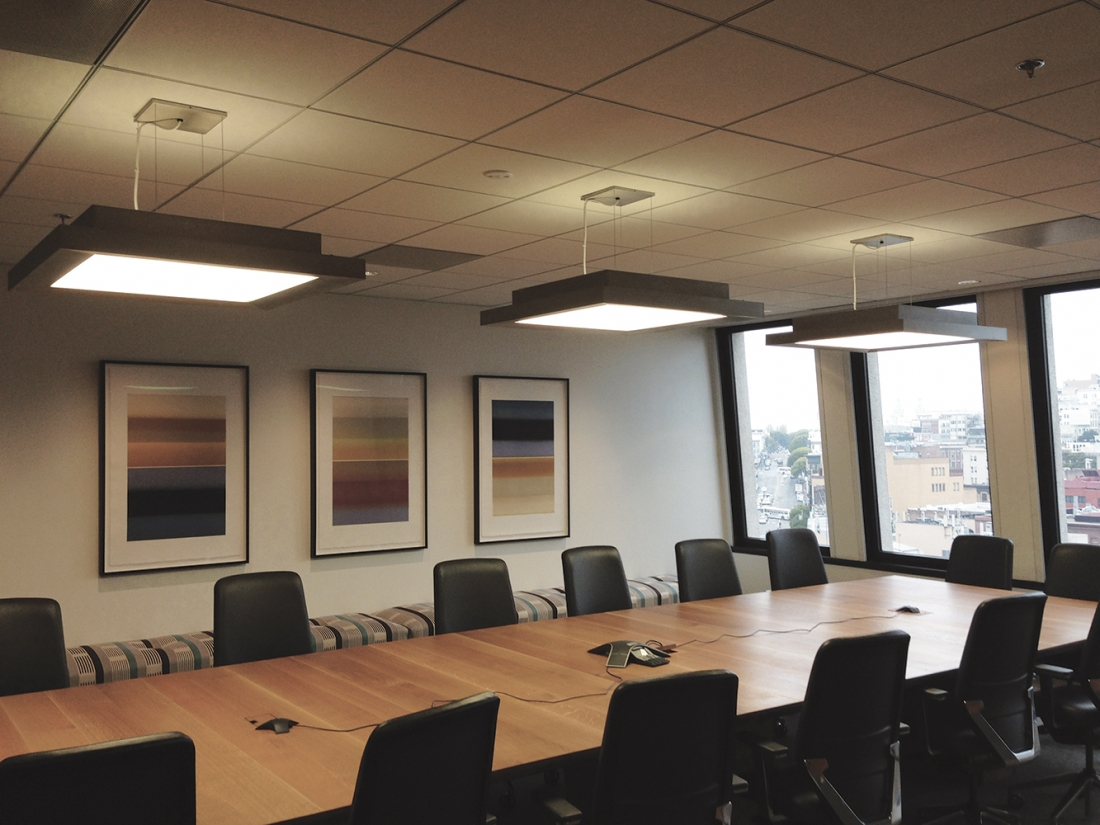 Fifth Avenue office lighting fixtures above a metropolitan workplace conference table