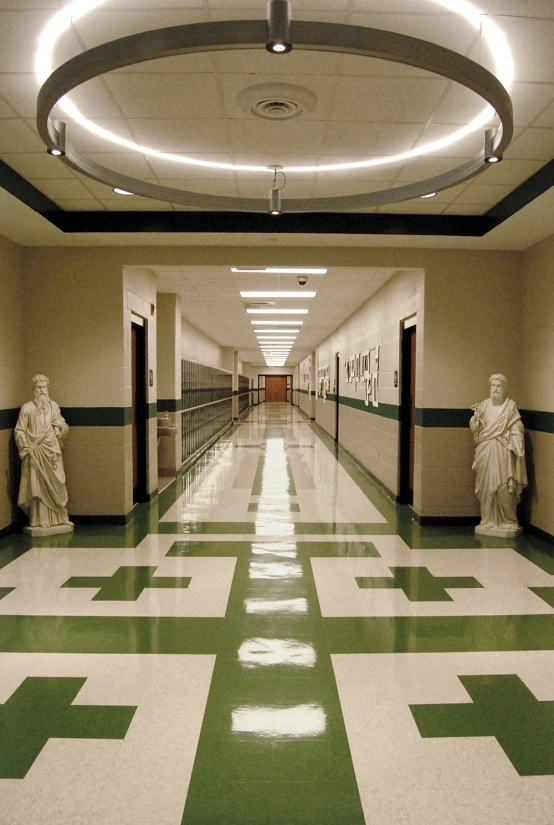 Infinity Art circular pendant above a school hallway for modern educational interior design.