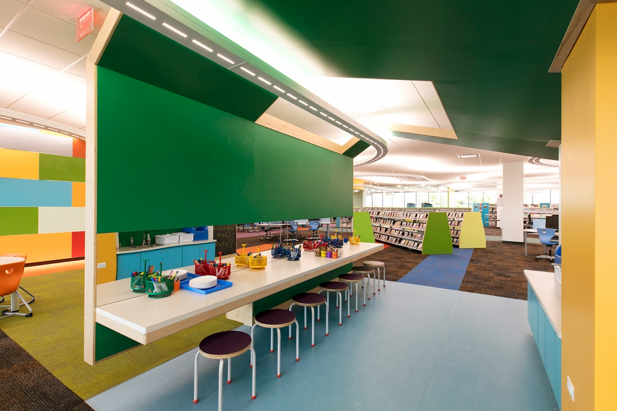 Infinity Performance configurable pendant in education lighting design above modern children's library.