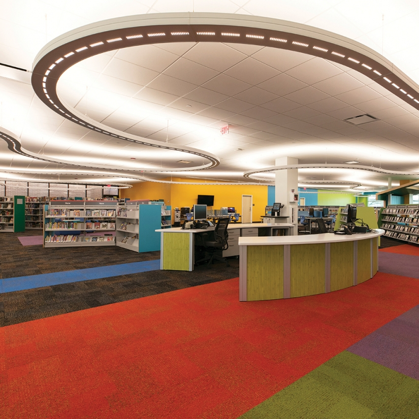 Infinity Performance configurable pendant in education lighting design above modern children's library.