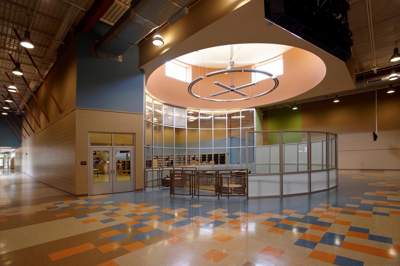 Infinity Performance configurable pendant in educational interior design above school seating area