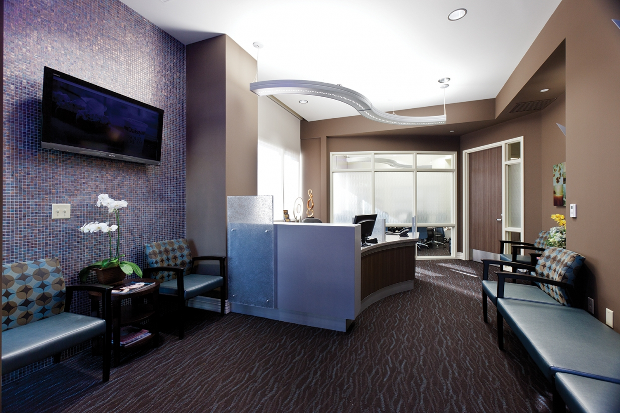 Infinity Performance in healthcare design above clinic reception desk.