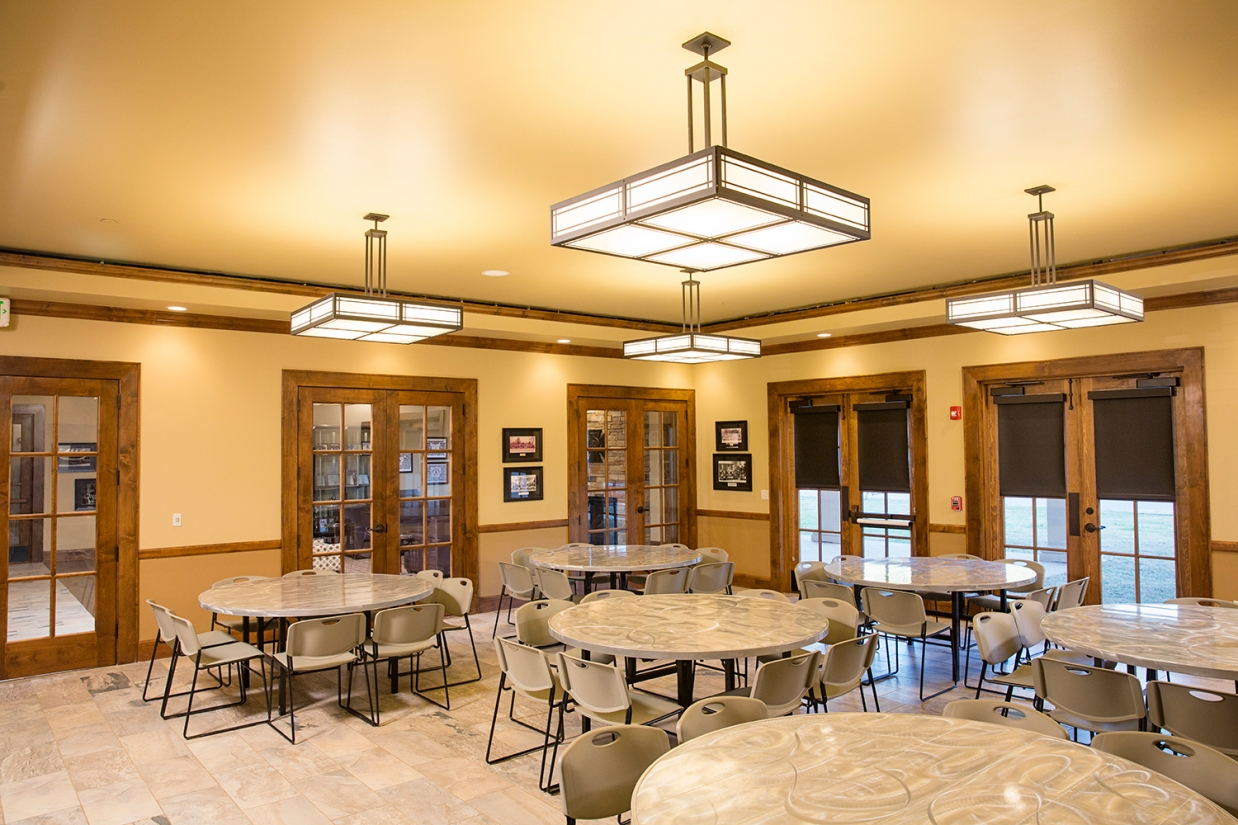 Midland Crafts pendants enhance educational interior design in a residence hall dining room.