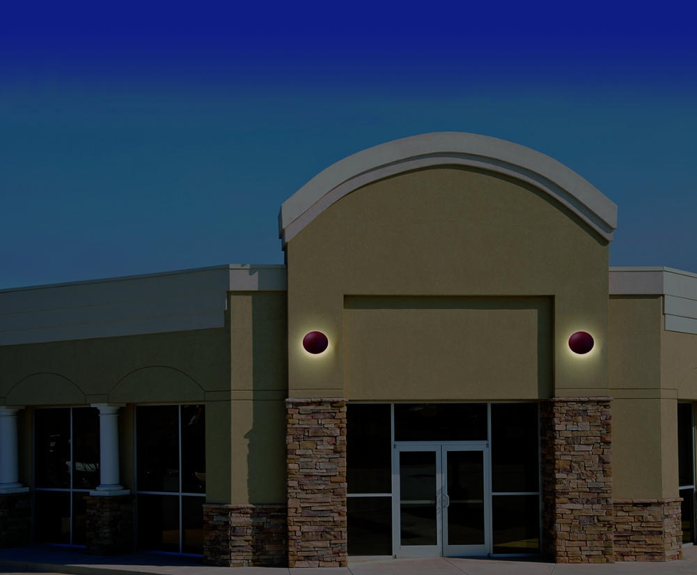 Northridge exterior lighting fixtures provide soft illumination on a commercial exterior entryway.