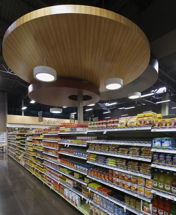 Omnience fixtures are good for retail lighting designs, seen here above the shelves of a modern grocery store.