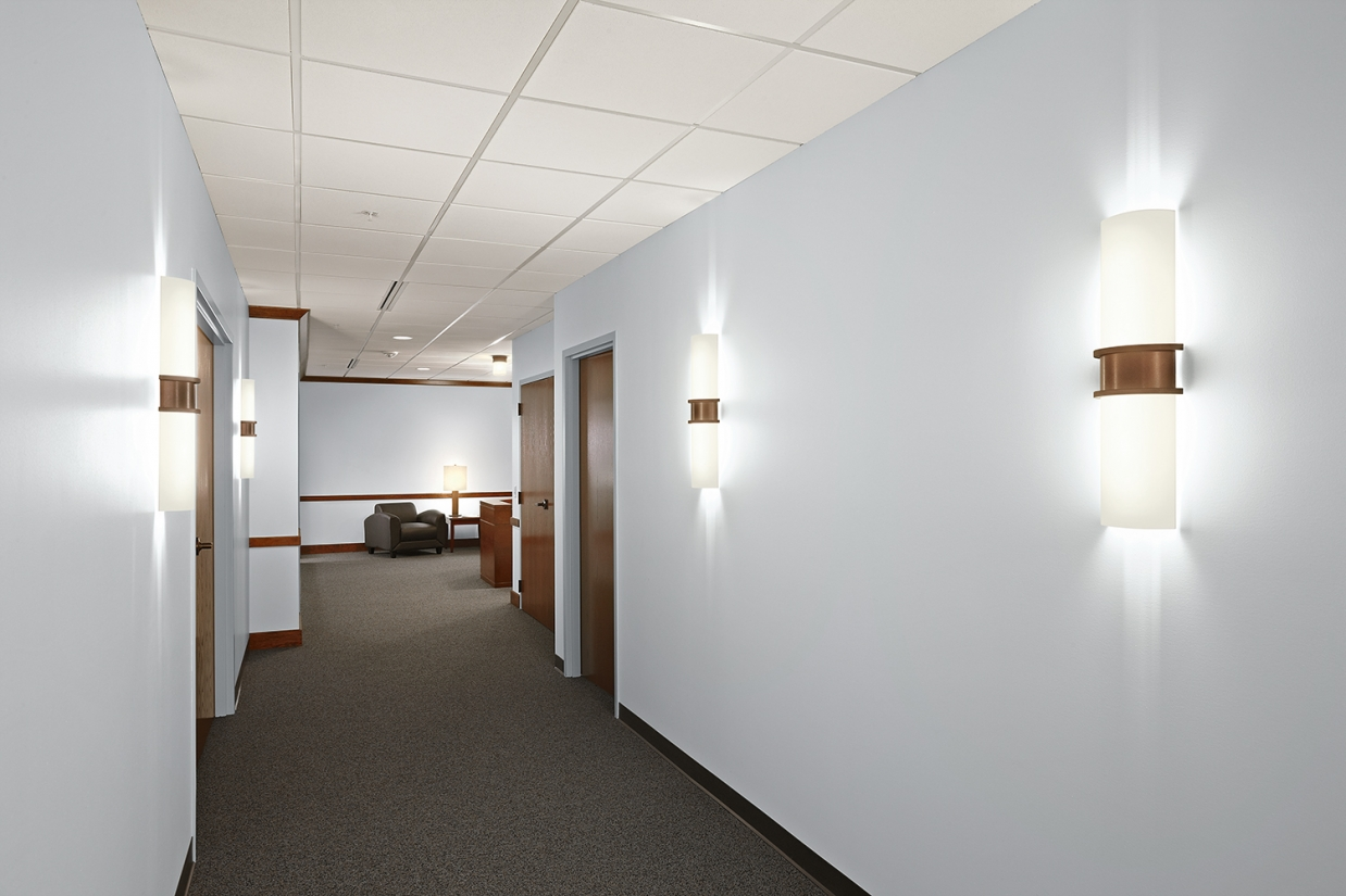 Pila sconces make stylish office lighting fixtures along a workplace corridor.