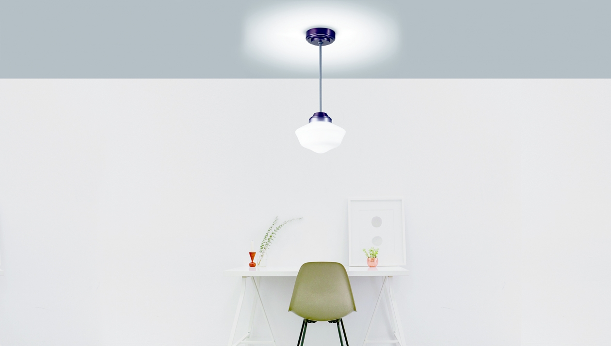 School Haus pendant in hospitality lighting design above a small desk area.