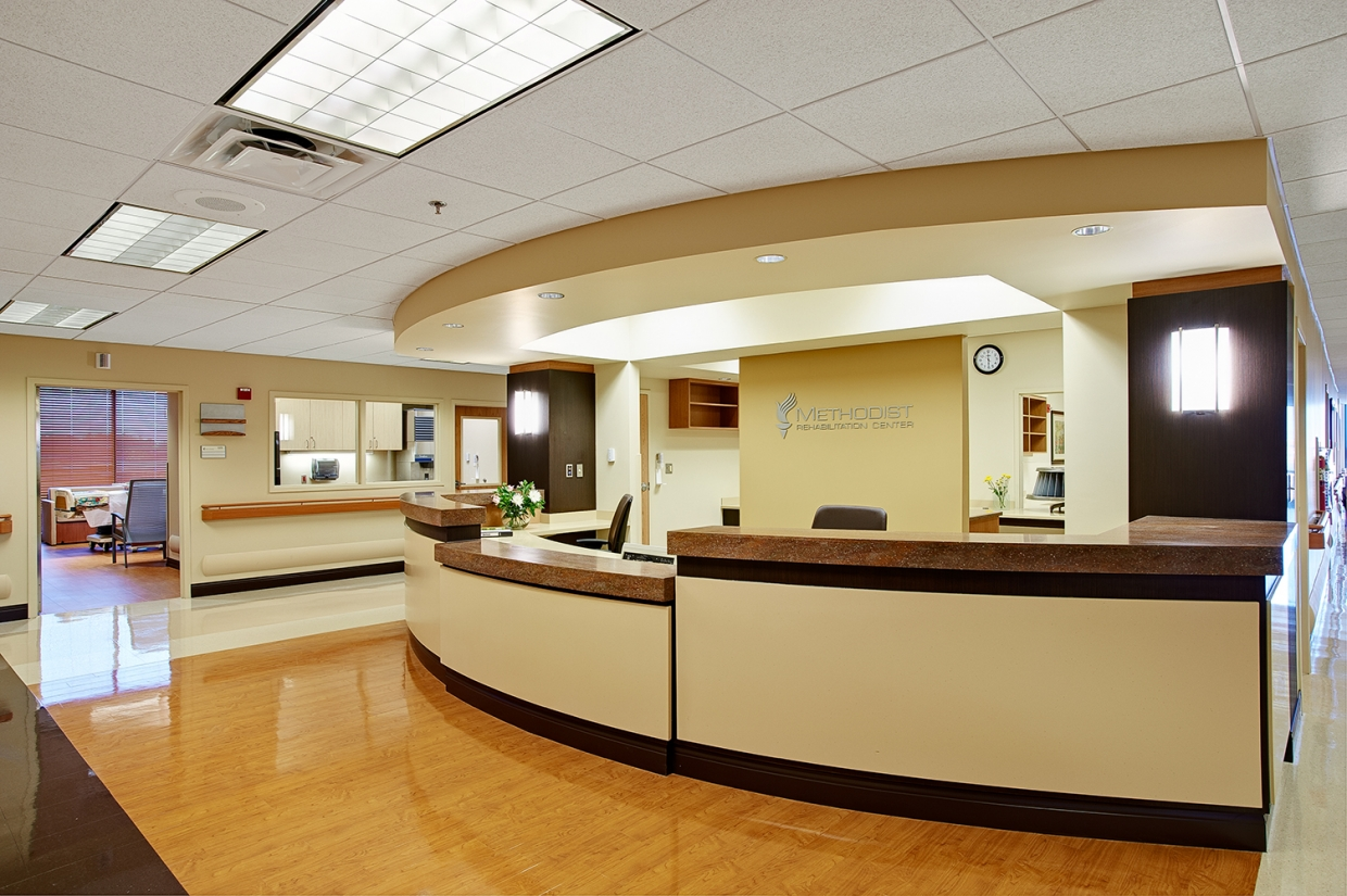 Select sconces provide stylish hospital lighting in a modern nurse's station.