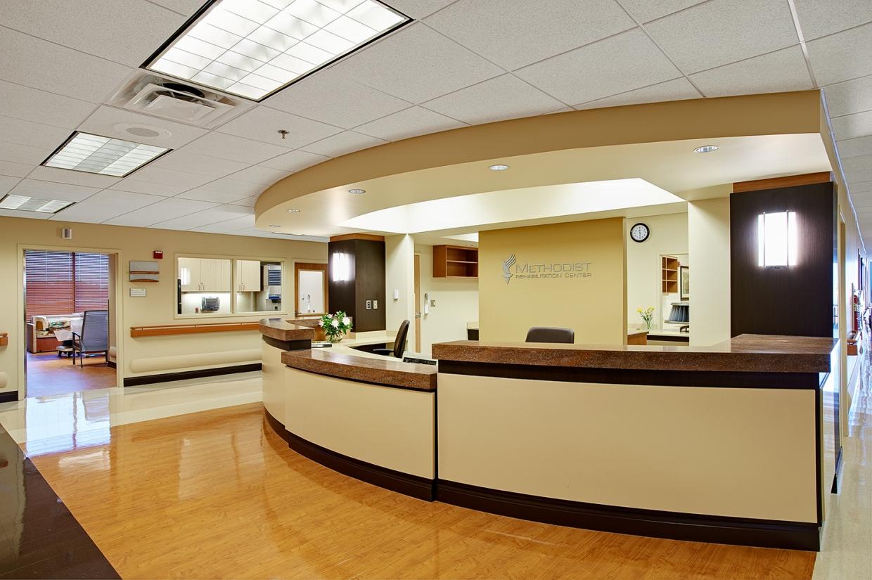 Select sconces provide stylish hospital lighting in a modern nurse's station.