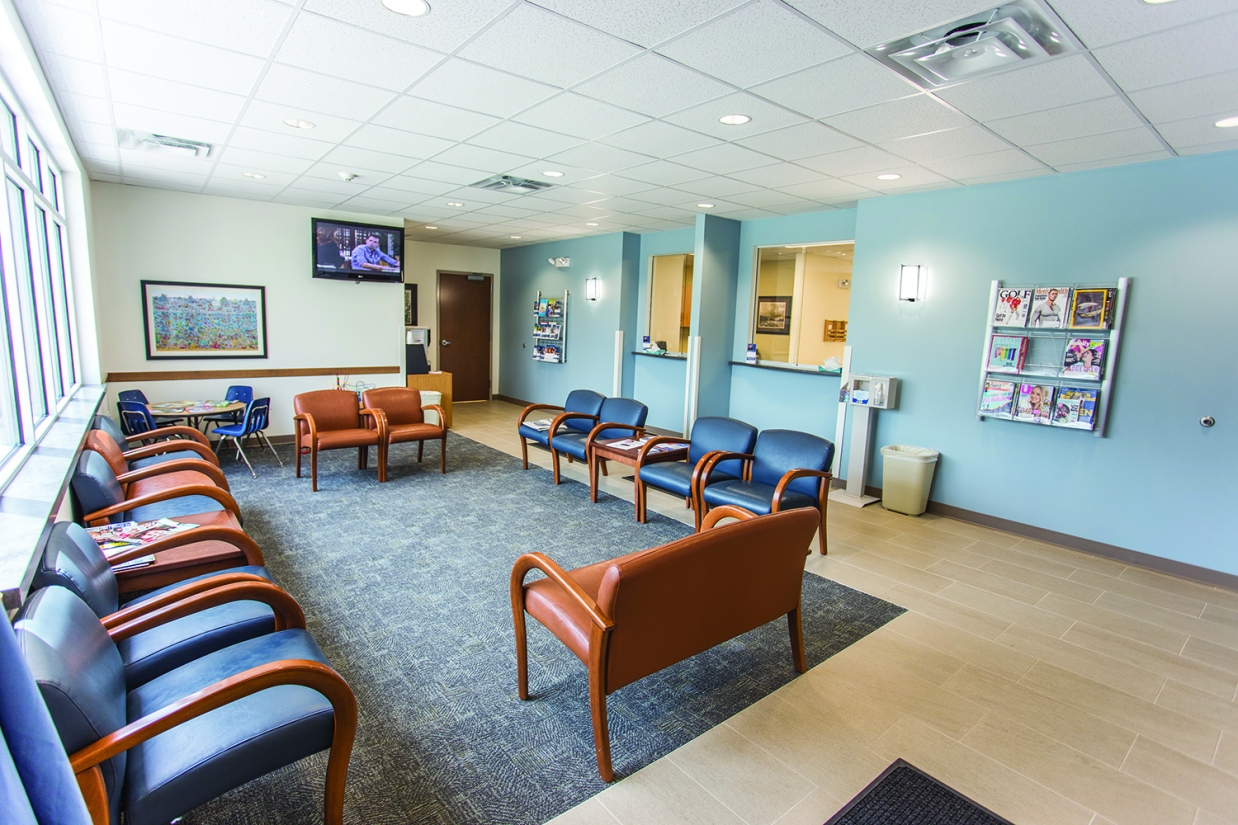 Select sconces provide stylish hospital lighting in a modern waiting room.
