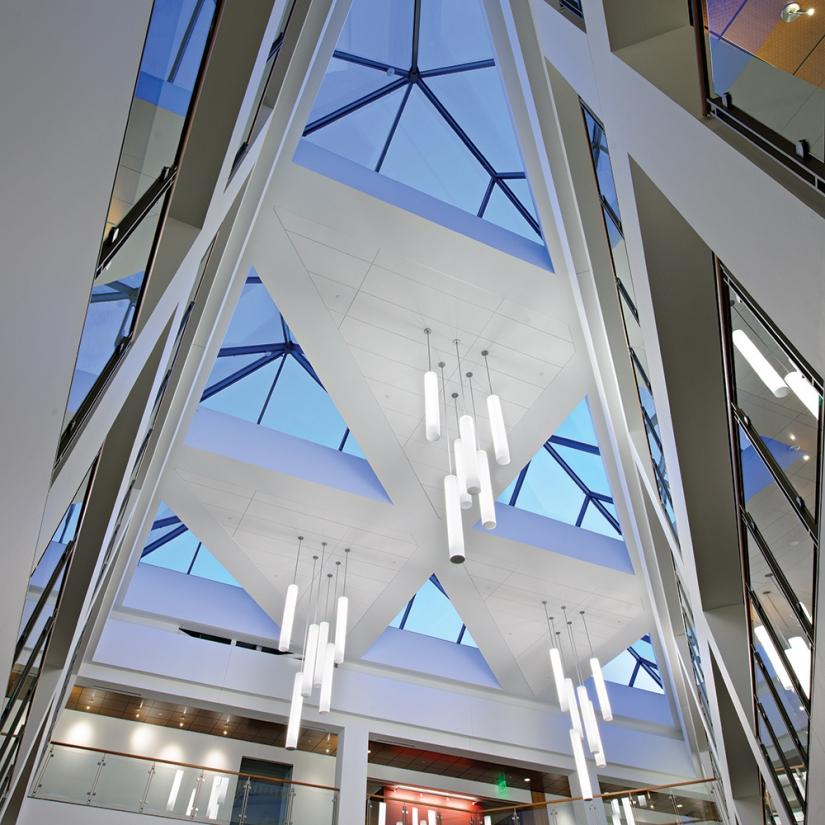 Sequence pendants enhance educational interior design in a large campus building atrium.