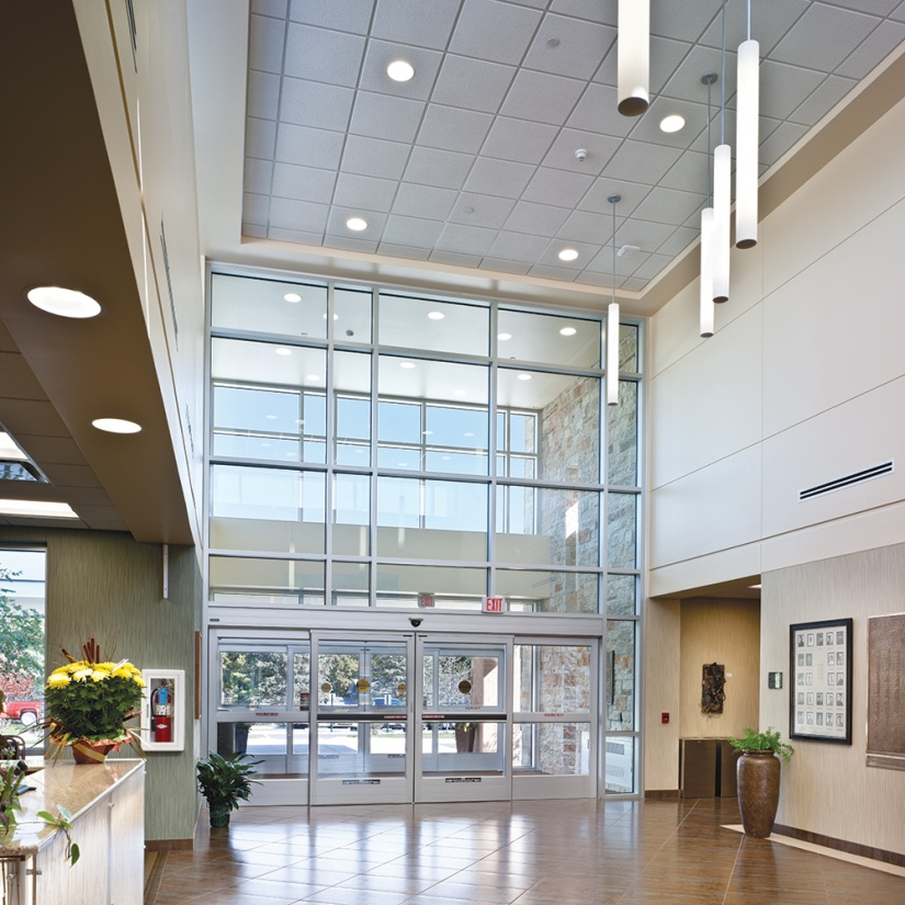 Sequence pendants feature in a large clinic lobby for airy healthcare design.