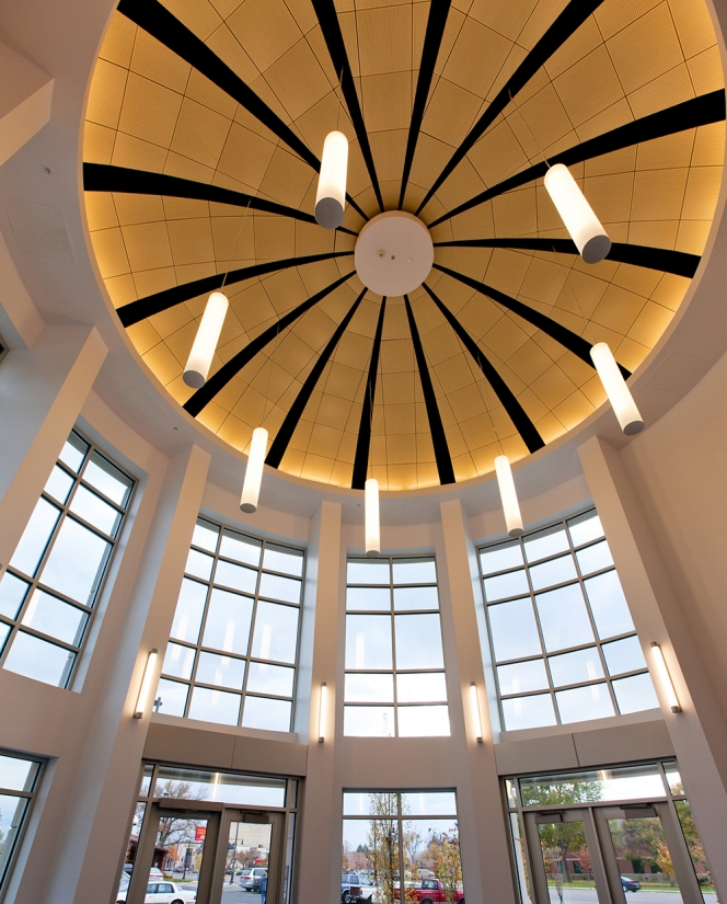 Sequence pendants in a circular configuration for a stylish entryway in a library lighting design.