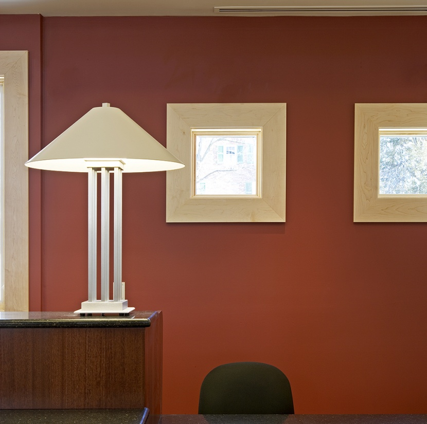 South Bay portable lamps serve as office lighting fixtures on a counter near a desk.