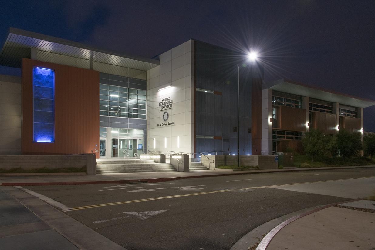 Southridge outdoor light illuminating a campus building at night.