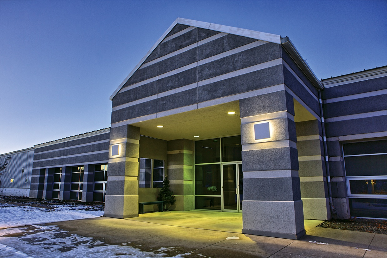 Southridge outdoor light fixture illuminating an office building entryway.