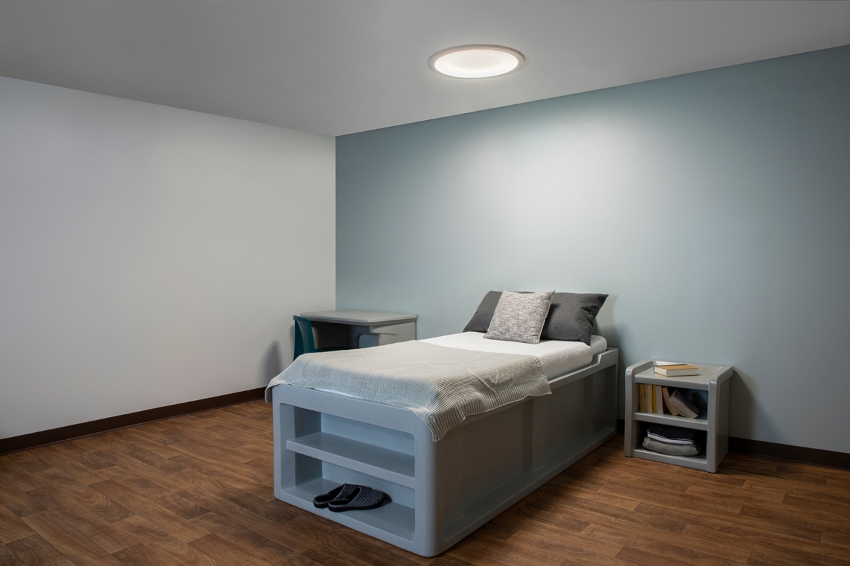 Symmetry behavioral health luminaire in a patient bedroom