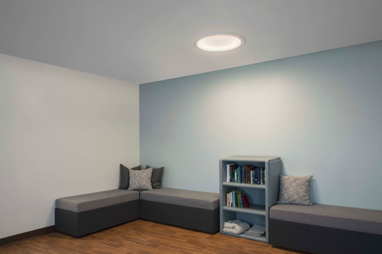 Symmetry ceiling luminaire in a behavioral health lounge area