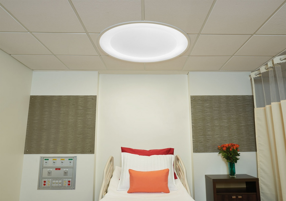 Symmetry patient room lighting fixture over a patient bed.