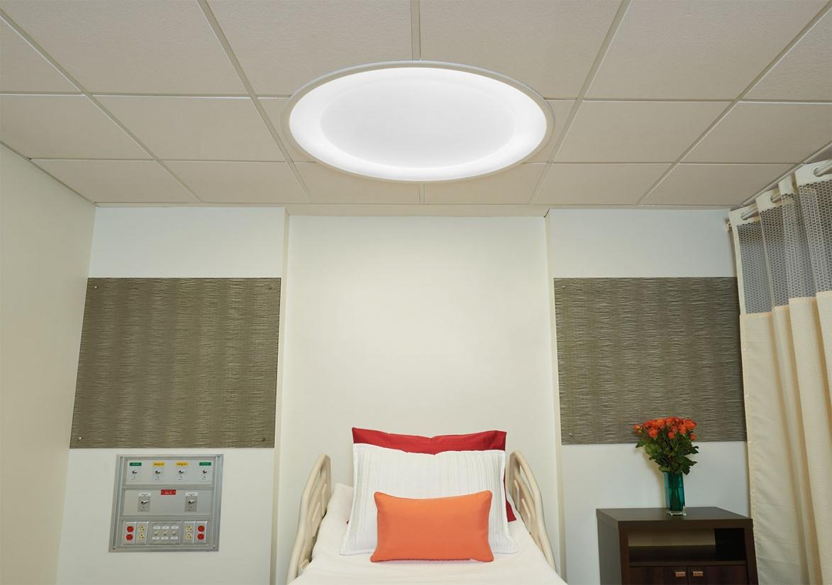 Symmetry patient room lighting fixture over a patient bed.