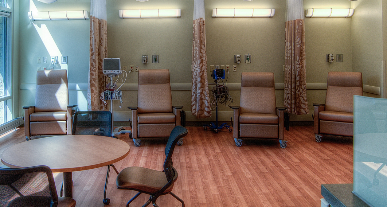 Tusk wall fixtures in a medical lighting design illuminate patient infusion seating area