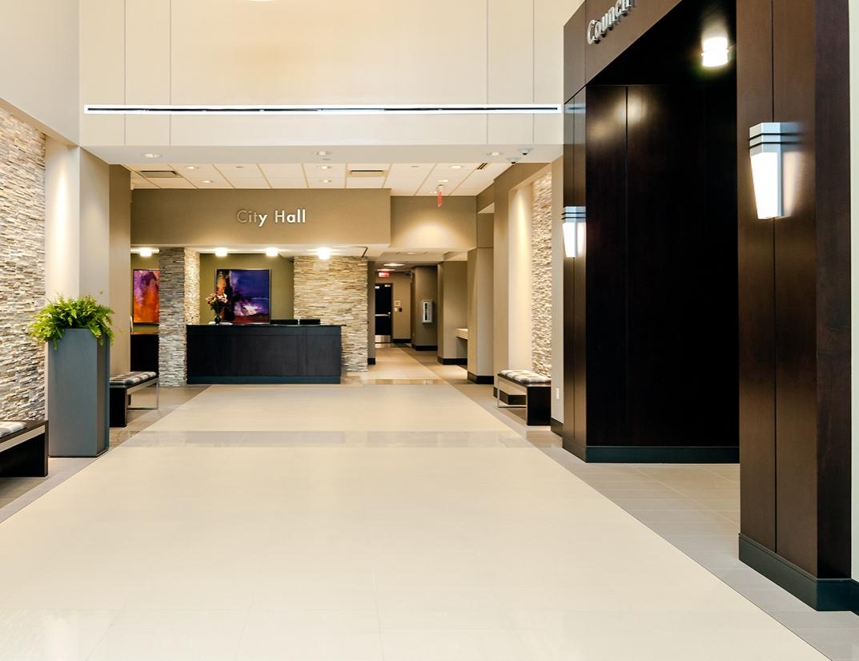 Wedge architectural lighting sconces illuminate a municipal center lobby