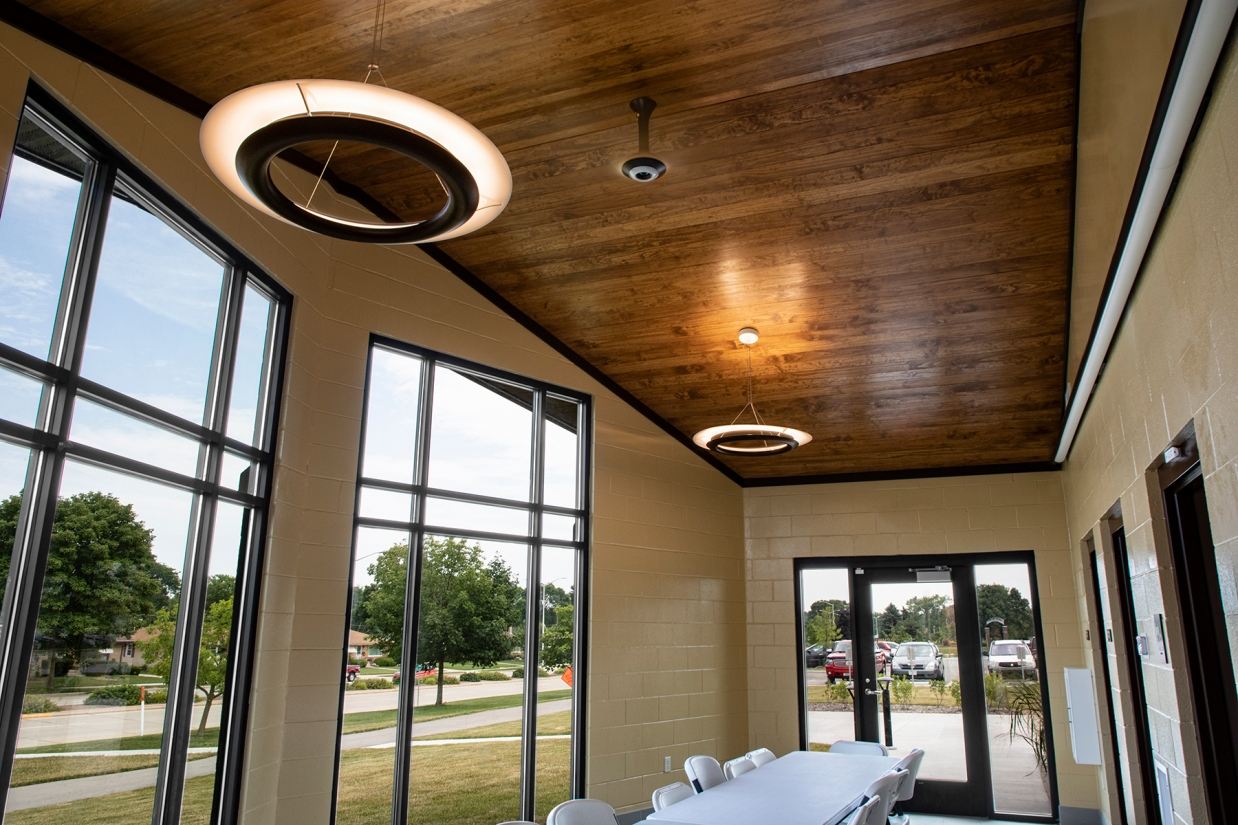 Cosmo ring pendants in a small conference room with big windows