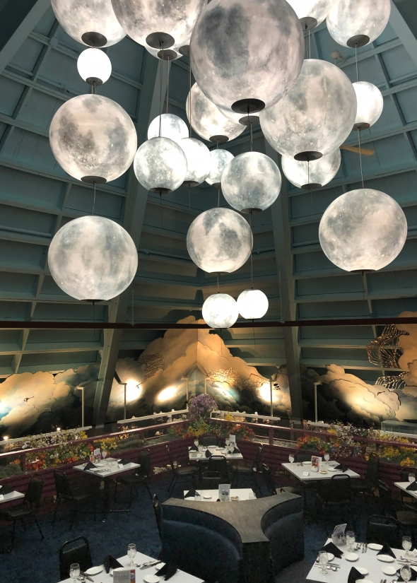 Custom moon-like globe pendants at the Fireside Theater, overlooking the dining area