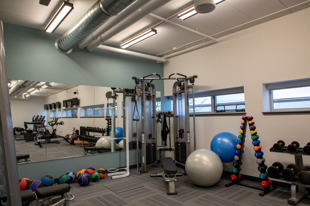 Latitude direct/indirect ceiling fixtures in a small office workout space