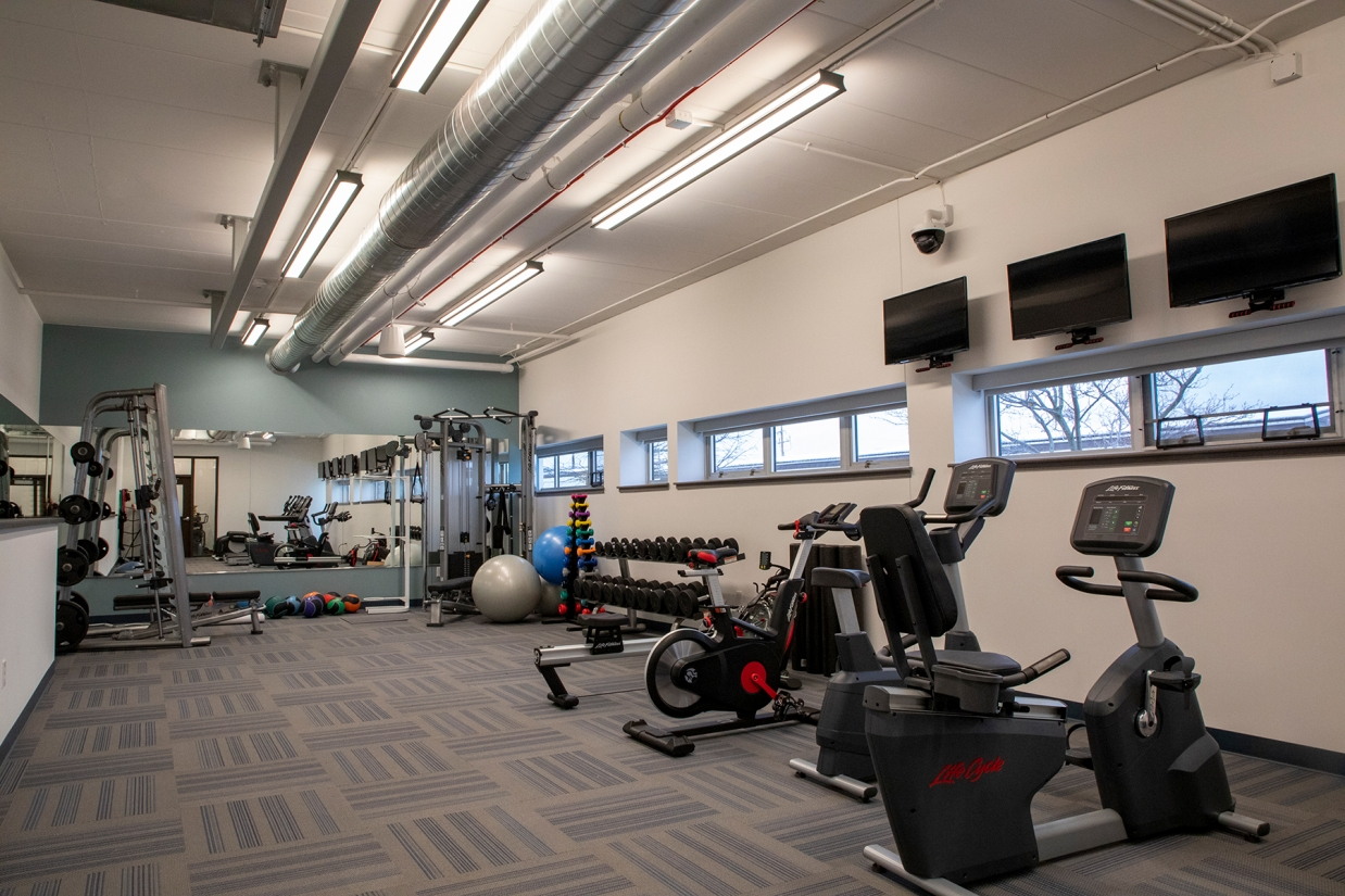 Latitude direct/indirect linear lighting in a workout space with low ceilings