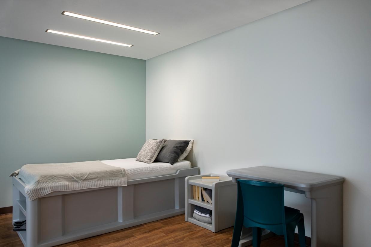 Lenga overbed slot fixtures in a behavioral health patient room