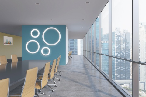 Meridian ring wall sconces in multiple sizes on a workplace wall