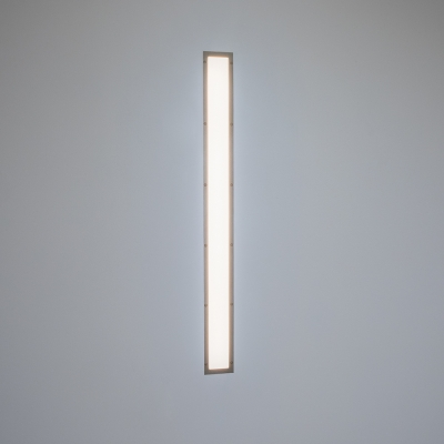 A behavioral health flush-mounted linear luminaire with diffuse luminosity