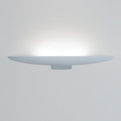 An uplighting wall sconce with a smooth, curved body in a light finish