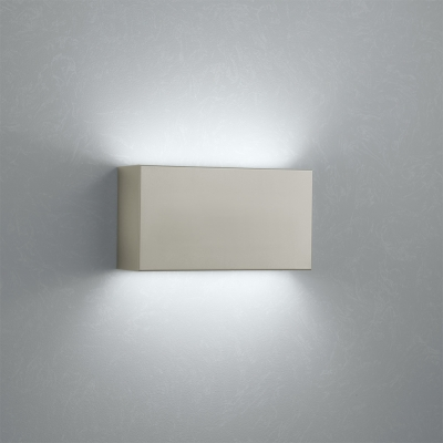 A box-like linear wall sonce with uplight and downlight