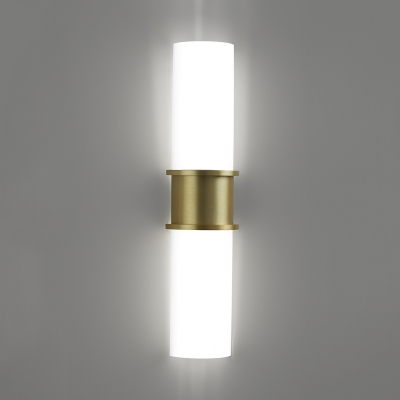 A large indoor wall sconce with luminous diffusers and a center accent