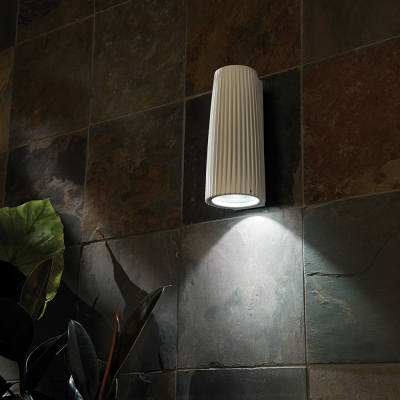A ridged cylinder wall sconce for outdoor mounting, with a downlight