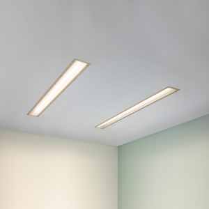 A thin dual unity overbed luminaire for patient lighting
