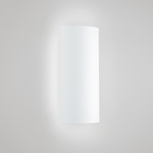 A rectangular wall sconce with a curved body