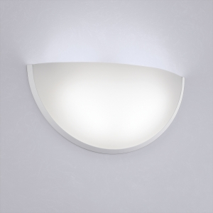 A clean, luminous quarter sphere wall sconce with minimal trim