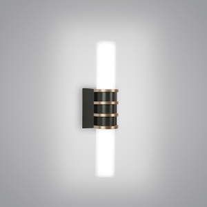 A small cylindrical sconce with a center trim
