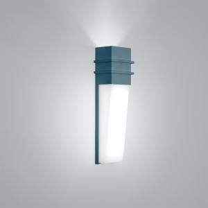 An indoor wall sconce in a solid wedge shape with uplighting