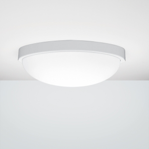 A simple round ceiling luminaire with a white trim