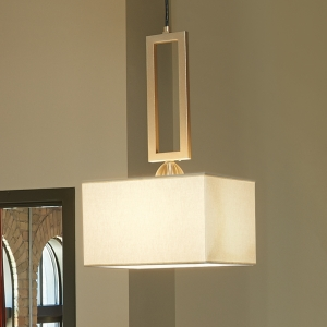 A hanging luminaire with a rectangular fabric shade and a square metallic mounting accessory