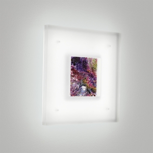 A small, square wall sconce with a luminous frame and inner artwork